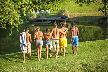 A large group of boys and girls, teenagers, running across a field, Maryland, USA