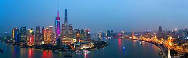 Skyline of the Pudong Financial district across Huangpu River at dusk, Shanghai, China, China