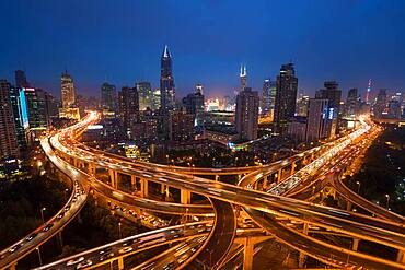 Elevated road junction and skyline of Shanghai, China at dusk, China