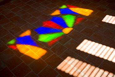 Close up of coloured light reflected through stained glass, Cuba