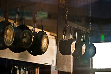 Pans hanging in commerical kitchen