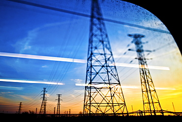 Power lines seen through car window