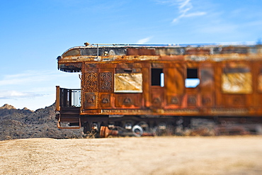 Rusty vintage train carriage in desert