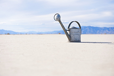 Watering can on salt flat