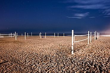 Beach volleyball nets on sand on beach
