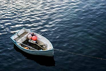 High angle view of small moored fishing boat.