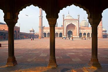 Jama Masjid Mosque Delhi, the courtyard at a mosque, with a colonnade with scalloped edged arches.