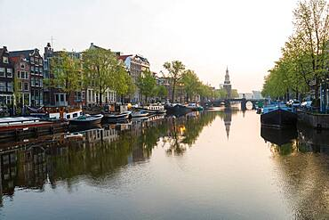 The Oudeschans canal in Amsterdam with the Montelbaanstoren tower in the background