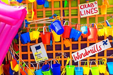 Bucket and spades and other beach items for sale, holiday resort, England, United Kingdom