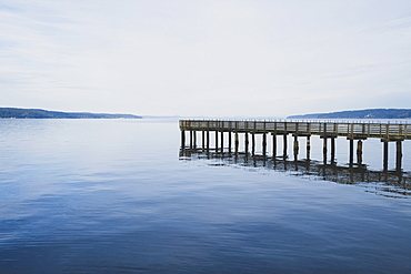 Pier in calm waters off Saratoga Passage, Whidbey Island, Washington