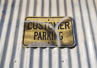 Customer Parking sign on warehouse exterior