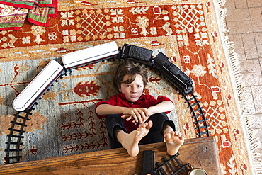 overhead view of young boy playing with his train