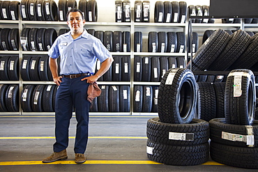 Portrait of Hispanic male owner in auto repair shop