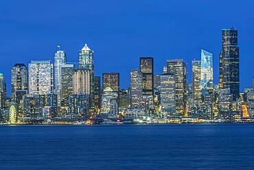 Seattle skyline, from Puget Sound, downtown buildings  at night.