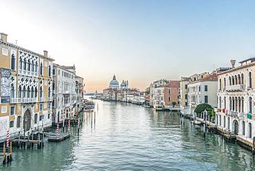 View of the Grand Canal in Venice with St Mark's Basilica dome in the distance.