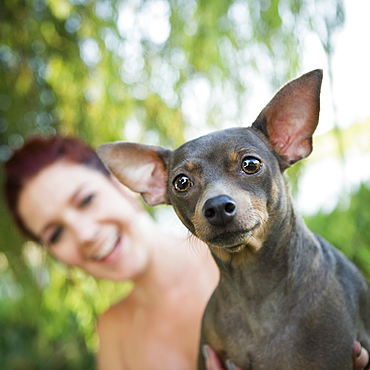 A woman with a small pet dog, Austin, Texas, USA