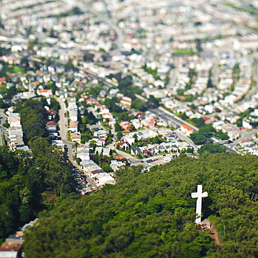 Urban sprawl with crucifix in park