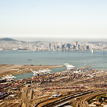 Aerial view of freight harbour with San Francisco skyline