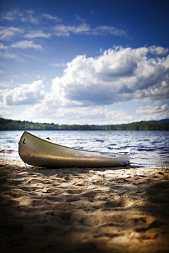 A canoe boat beached on the shore of a lake or river, USA
