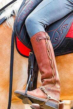 Horse rider with ornate leather riding boots, Tuscany Italy