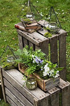 Crate with wild flowers, decorations for a woodland naming ceremony.