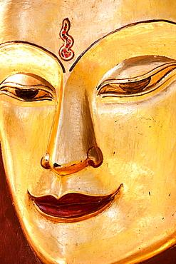 Sculpture of a Buddha. Close up of the face, Mandalay, Myanmar, Mandalay, Myanmar