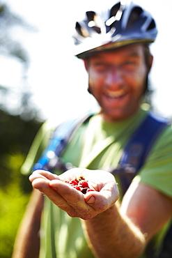 Hiker on Trail with Native Raspberries, Cape Breton Island, Nova Scotia, Canada