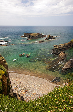 View from the clifftops onto the rocky shore and headlands of the Atlantic coastline, Almograve, Portugal