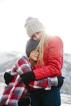 A brother and sister hugging each other, Mountains, Utah, USA