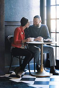 A couple seated side by side at a cafe table, Cafe, Utah, USA
