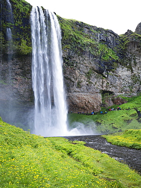 A waterfall cascade over a sheer cliff, Iceland