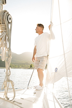 Portrait of a blond man on a sail boat.