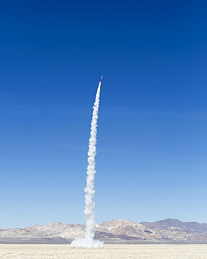 Rocket shooting into vast, desert sky, Black Rock Desert, Nevada, United States of America