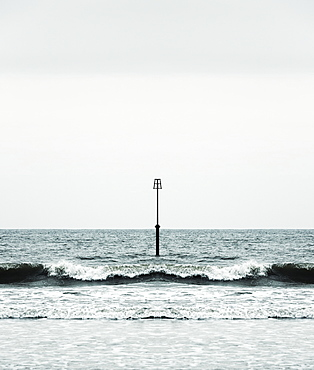 Beacon and Ocean Waves, Yorkshire, England, UK