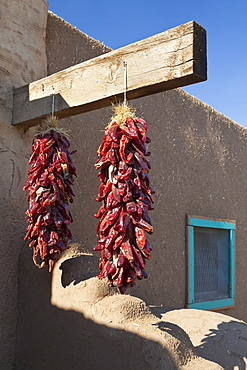 Red Chili Peppers Hanging Outdoors, Taos, New Mexico, United States of America