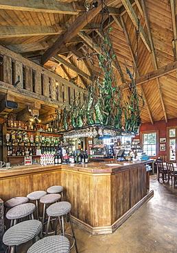 Empty bar and stools in restaurant, Moreaki, Moreaki, New Zealand