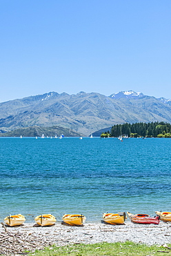 Kayaks docked along beach, Lake Wanaka, Otago, New Zealand, Lake Wanaka, Otago, New Zealand