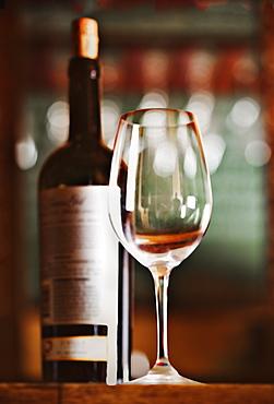 Close up of bottle of wine and glass, Tacoma, Washington, USA