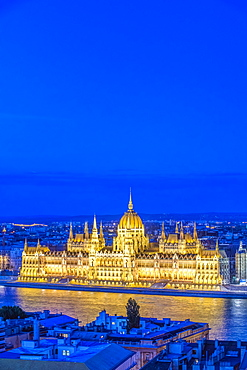 View of Parliament Building illuminated at dusk, Budapest, Hungary