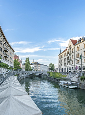 Buildings and pedestrian bridge over urban canal, Ljubljana, Central Slovenia, Slovenia