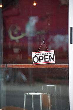 Close up of open sign on cafe door