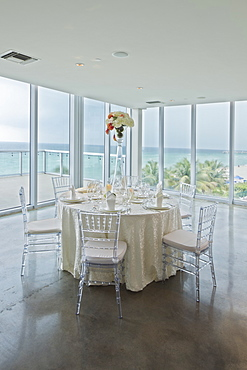 Empty tables in banquet hall, Miami, Florida, USA