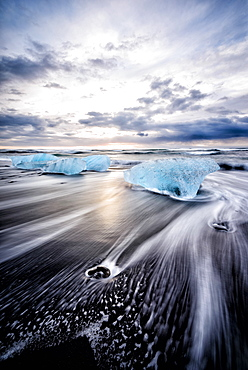 Glaciers washing up on remote beach, Jokulsarlon, Iceland