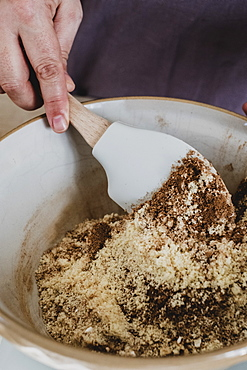 High angle close up of person mixing baking ingredients using spatula, England