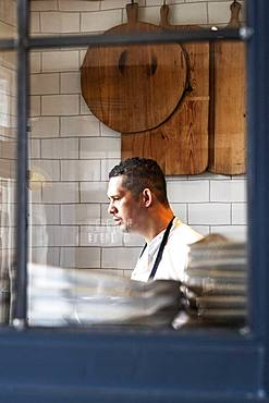 Portrait of male chef standing in a kitchen