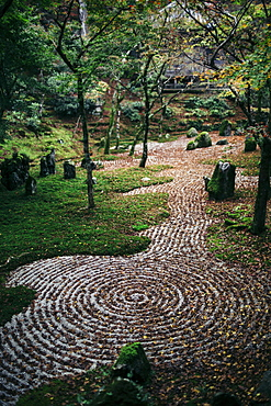 Gravel path with concentric patterns at a zen rock garden, Kyushu, Japan