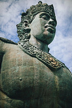 Low angle view of large stone statue of Hindu deity Vishnu, Indonesia