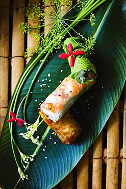 High angle close up of Vietnamese spring rolls served on a banana leaf, Vietnam