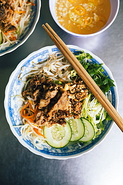 High angle close up of Bun thit nuong-rice noodles with grilled pork and fresh herb, Vietnam