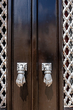 Door knockers in the form of a hand, Algarve, Portugal